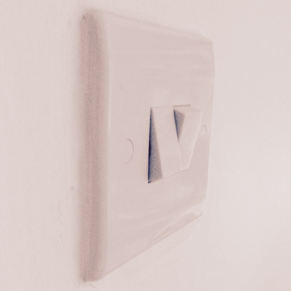 White double light switch, one on, one off